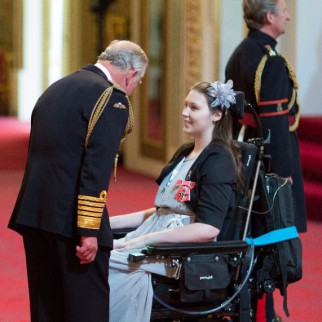 Lucy receives her MBE from HRH Prince Charles.  Photo courtesy British Ceremonial Arts Ltd.